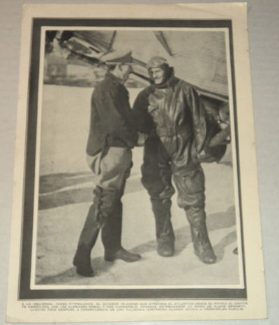 Image for A vintage magazine photographic illustration of the IRISH AVIATOR PIONEER JAMES FITZMAURICE, who flew on the first East to West Trans-Atlantic flight, shaking the hand of American aviator FLOYD BENNETT, Byrd's pilot during his expedition to the North Pole who also flew the relief mission to the Bremen aviators.