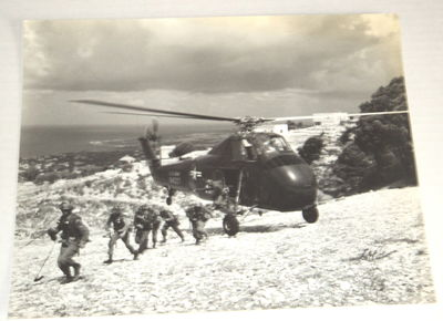 Image for A SUPERB BLACK & WHITE PHOTOGRAPH DISTRIBUTED BY STARS & STRIPES DEPICTING U.S. TROOPS DISEMBARKING FROM A HELICOPTER IN LEBANON IN 1958