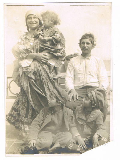 Image for A VINTAGE BLACK & WHITE PHOTOGRAPH OF A ROMANI OR GYPSY FAMILY