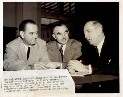Image for A WONDERFUL VINTAGE NEWS PHOTOGRAPH TAKEN CIRCA 1953-4 DEPICTING THEN-SENATOR LYNDON JOHNSON CHAIRMAN OF THE SENATE ARMED SERVICES COMMITTEE WITH SENATOR WAYNE MORSE AND SENATOR RICHARD RUSSELL OF GEORGIA
