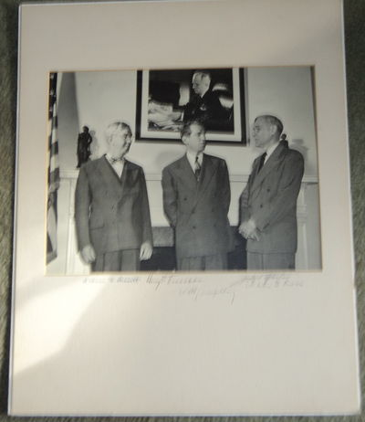 Image for AN ORIGINAL PHOTOGRAPH SIGNED BY PRESIDENT HARRY S. TRUMAN, WILLIAM HASSETT, MATTHEW J. CONNELLY, CHARLES G. ROSS AND THE PIONEERING WOMAN PHOTOGRAPHER JACKIE MARTIN.
